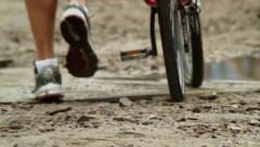 Aftermath of natural disaster flood, man with bicycle, dirty, click for HD Stock Footage