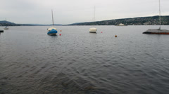 HD1080 30p covered sail boats on lake Zurich Stock Footage