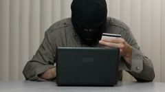 Scam Hacker With Credit Card And Computer - Ready  To Rob Stock Footage