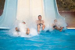 people at aqua park - stock photo