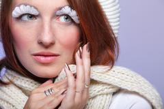 Portrait of creative make up winter girl with false white long eyelashes Stock Photos