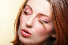 Portrait of creative make up woman with false long orange eyelashes Stock Photos
