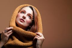 Young creative make up woman with false long orange eyelashes and warm scarf - stock photo