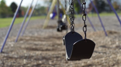 Empty swingset slow motion 120fps Stock Footage