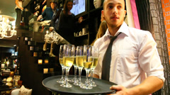 A waiter serves champagne to customers Stock Footage