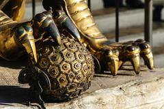 The bronze hydrangea under claws of lion sculpture Stock Photos