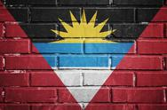 Stock Illustration of antigua and barbuda flag on a textured brick wall