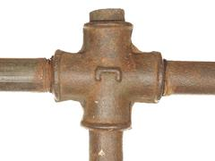 A fragment of the old water conduit consisting of pipes and fittings. Stock Photos