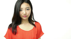 Asian girl orange sundress isolated on white with help wanted sign Stock Footage