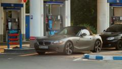 Service for rich, gas station timelapse blonde in elite car, click for HD Stock Footage