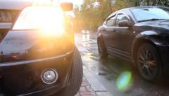 Cars traffic rain, city vehicles drive by, wet tarmac weather, click for HD Stock Footage