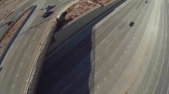 Aerial view of freeway overpass with cars passing under - stock footage