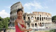 Sunscreen woman applying suntan lotion, Colosseum Stock Footage