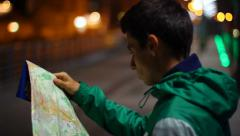 Lost tourist not citizen looking searching location map night, click for HD - stock footage