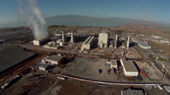 Stock Video Footage of Aerial view of natural gas power plant fly in