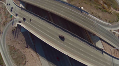 Aerial view of freeway overpass with traffic below - stock footage