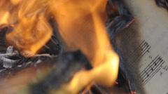 Sheet music burning in fire Stock Footage