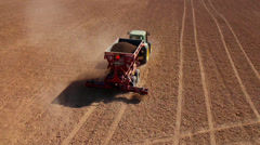 Tractor with a cart  spreader Fertilizer Stock Footage