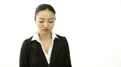 Asian business woman isolated on white confused with qestion mark sign Stock Footage