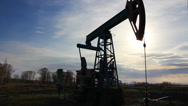 Stock Video Footage of working oil pump at sunset