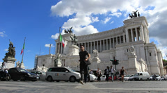 Running across the road from 'Wedding cake' monument in Rome Stock Footage