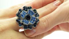 Stock Video Footage of jewelery ring with blue sapphire crystals putting on the finger