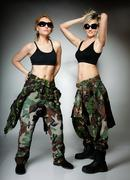 Two women in military clothes, army girls Stock Photos
