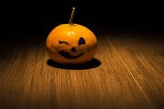 tangerine jack o'lantern - stock photo