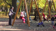 Stock Video Footage of Children's playground, kids and parents in the park, fall season, autumn colors