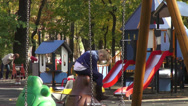 Stock Video Footage of Children's playground, happy kid in the park, fall season, autumn colors