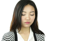 Asian girl isolated on white worried scratching head Stock Footage