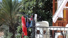 Washed clothes dry at the balcony Stock Footage