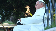 Pope (lookalike) reading the bible 2 - stock footage