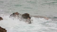 sea waves breaking on rock - slow motion - stock footage