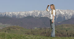 Ultra HD 4K Pretty young blonde woman peak snow trip joy admire nature mountains - stock footage
