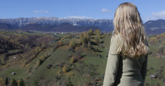 Ultra HD 4K Beautiful blonde girl woman enjoy rural landscape mountain autumn Stock Footage