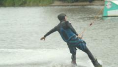 Riding wakeboard man shows tircks and summersaults, water sport, click for HD - stock footage