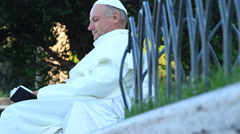 Pope (lookalike) reading the bible 1 Stock Footage
