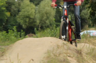 Stock Video Footage of Action shot of two competitors riding BMX bicycle racing against, click for HD