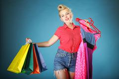 girl with shopping bags retro style - stock photo