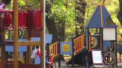 Children's playground, happy kids on the slide, fall season, autumn colors - stock footage