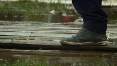 Natural catastrophe, legs passing by through water and dirt, click for HD - stock footage