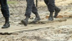 Military forces boots step over dirt, rescue emergency situation, click for HD Stock Footage