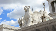 Feet pass statue at Vittorio Emanuele II monument in Rome Stock Footage