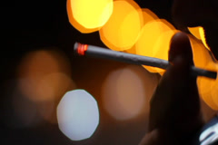 Cigarette in hand smoking male night city traffic, anti-tobacco, click for HD - stock footage