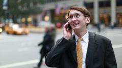 Caucasian businessman in New York city on cellphone Stock Footage