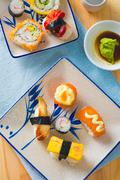 various assorted sushi on a plate - stock photo
