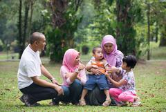 Malay family having fun in the park ,malaysian people Stock Photos