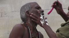 indian street barber shaving hindu brahman monk - stock footage