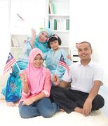 Malay family with malaysian flag lifestyle photo Stock Photos